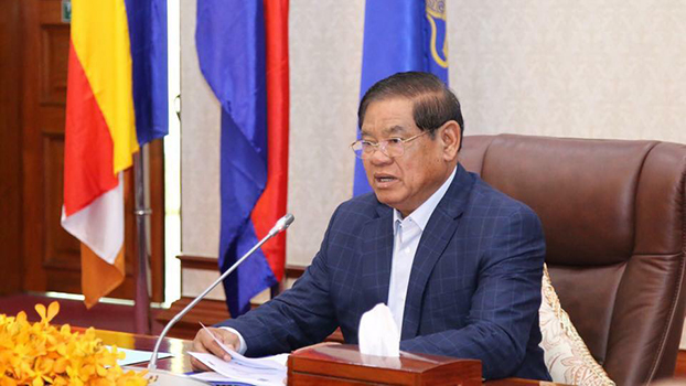 Minister of Interior Sar Kheng speaks at an inter-ministerial meeting Nov 27 to discuss amending laws intended to protect Laos' natural resources.