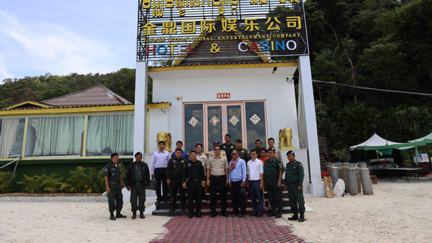 Police and court officials in Cambodia's Sihanoukville close the Chinese-owned Jin Ding Hotel and Casino, May 24, 2019.