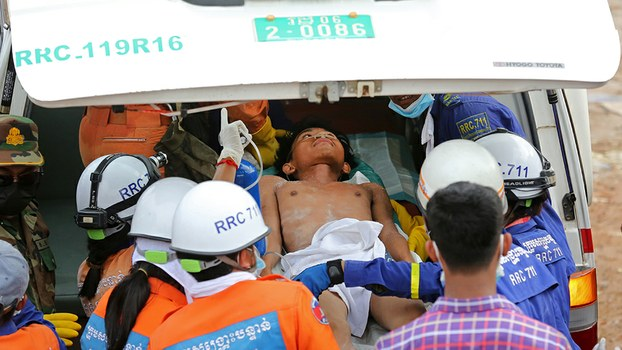 A survivor is placed in an ambulance after being pulled out of the rubble of a collapsed building in Sihanoukville, June 24, 2019.