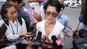 Theary Seng, a defendant in a mass treason trial of critics of Cambodian Prime Minister Hun Sen, speaks to media in front of Phnom Penh Municipal Court, Nov. 26, 2020.
