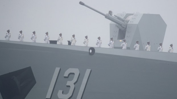 Chinese People's Liberation Army (PLA) Navy sailors stand on the deck of a new guided-missile destroyer as it participates in a naval parade in the sea near Qingdao, in eastern China's Shandong province, April 23, 2019.