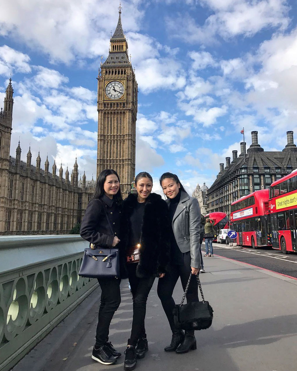 Posing in front of the Houses of Parliament: Neth Vichhuna (right) pictured with her aunts Hun Chantha (center) and Hun Chanthou (left) in London.