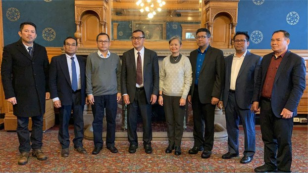 Sam Rainsy (center-left) and seven other senior CNRP officials charged with plotting a coup against Cambodia's government pose in Washington, in an undated photo.