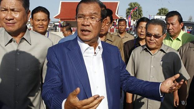 Cambodian Prime Minister Hun Sen gestures while speaking in Phnom Penh, Aug. 1, 2018.