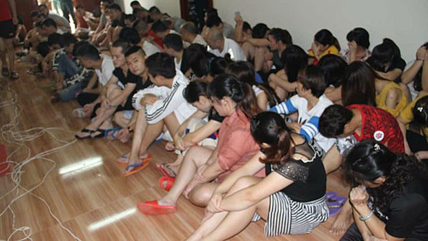Chinese nationals arrested by Cambodian police in cooperation with China are shown in a Nov. 26, 2018 photo.