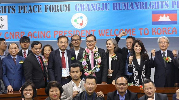 Sam Rainsy (C) gathers with CNRP leaders and activists in Gwangju, South Korea, April 19, 2019.