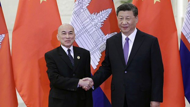 Chinese President Xi Jinping (R) shake hands with Cambodian King Norodom Sihamoni (L) at the Great Hall of the People in Beijing, May 14, 2019.