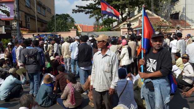 Cambodian protesters block a street in front of the Ministry of Information during a protest in Phnom Penh, in a file photo.