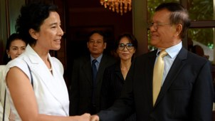 French Ambassador to Cambodia Eva Nguyen Binh shakes hands with former opposition leader Kem Sokha at his home in Phnom Penh, Nov. 11, 2019.