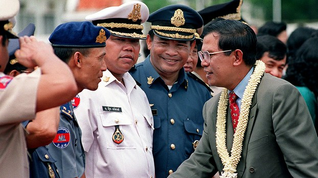Cambodia's Prime Minister Hun Sen (R) speaks with Sao Sokha (3rd from left) on his arrival at the airport in Phnom Penh, in a file photo.