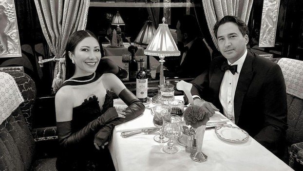 Hun Chantha, niece of Cambodian Prime Minister Hun Sen, and her husband Gerald Dupuis, a Belgian-Cambodian investment banker and heir, having dinner aboard the Orient Express.