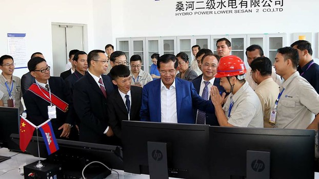Cambodia's Prime Minister Hun Sen (C) inaugurates the 400 megawatt Lower Sesan 2 hydropower plant during a ceremony in Stung Treng province, Dec. 17, 2018.