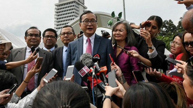 Cambodia's exiled opposition leader Sam Rainsy talks to reporters after meeting legislators at the Parliament House in Kuala Lumpur, Nov. 12, 2019.