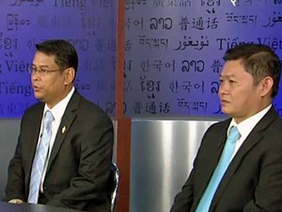 CNRP lawmakers Nhay Chamroeun (L) and Kong Sophea (R) are interviewed at RFA's headquarters in Washington, Dec. 28, 2015. Credit: RFA