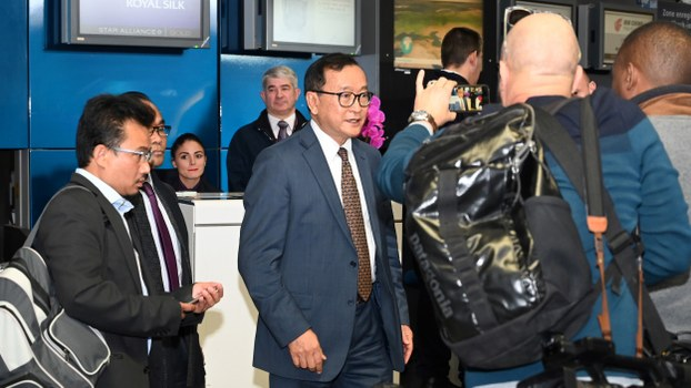 Leader of the Cambodia National Rescue Party (CNRP) Sam Rainsy leaves a boarding counter after failing to board a flight to Bangkok at the Roissy-Charles de Gaulle airport, north of Paris, Nov. 7, 2019.