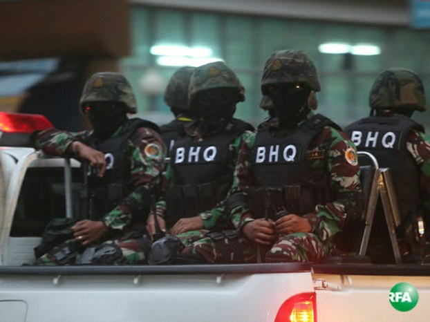 Troops wearing masks on patrol near Cambodia National Rescue Party Headquarters, Aug. 31, 2016.