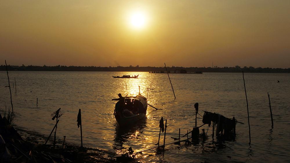 A wooden boat anchored along the Mekong River bank near Phnom Penh, Cambodia, April 24, 2019. Credit: AP Photo