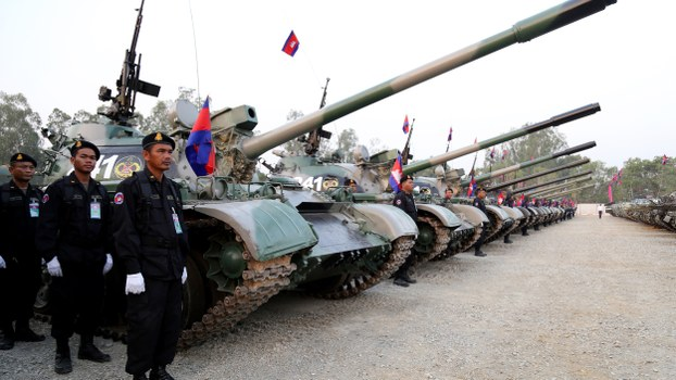 Cambodian soldiers stand next to tanks during a ceremony marking the 20th anniversary of the formation of Cambodian Infantry Army in Phnom Penh, Jan. 24, 2019.