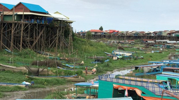 Scattered boats are seen in the dried up tributary that connects to the Tonle Sap lake in Kampong Khleang, Cambodia July 6, 2020.