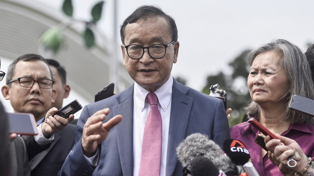 Sam Rainsy speaks with reporters after meeting with lawmakers at Malaysia's parliament in Kuala Lumpur, Nov. 12, 2019.
