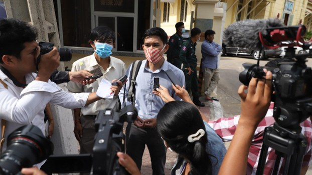 Uon Chhin (L) and Yeang Sothearin (R) speak with reporters outside the Supreme Court in Phnom Penh, July 15, 2020.