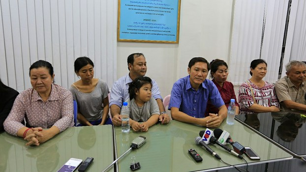 Lim Mony (first from left), Nay Vanda (third from left), Ny Sokha (fourth from right), and Yi Sokan (first from right) speak to the media in Phnom Penh after their release from pre-trial detention, June 29, 2017.