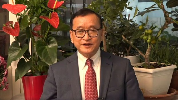 In a screen grab of a video, Sam Rainsy speaks to supporters from his home in Paris, France, Nov. 4, 2019.