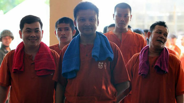 Hun Sen bodyguards Chhay Sarith (L), Mao Hoeun (C) and Sot Vanny (R), who served only one year of their four-year sentences for the October 2015 beating of Cambodian opposition politicians, are shown on their way to Phnom Penh Municipal Court, May 10, 2016.