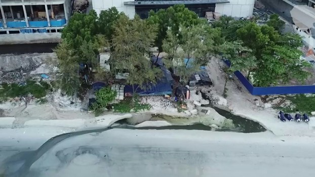 A screen grab from a video shows an aerial view of what appears to be sewage streaming out of the Sunshine Bay Hotel and Casino, Sihanoukville, Cambodia.