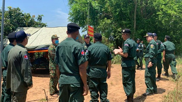 Cambodian police confront Vietnamese soldiers in a disputed area of the border, April 26, 2020.