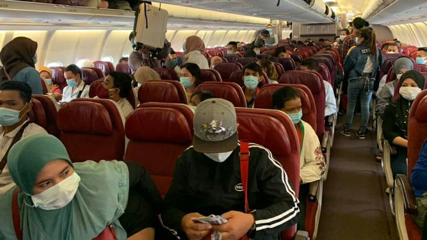 A group of Cambodians who were stranded in Malaysia for up to four months board a plane returning to Cambodia, June 16, 2020.