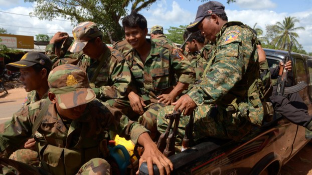 Cambodian soldiers sit in a pickup truck as they travel along a road in Preah Vihear province, in a file photo.