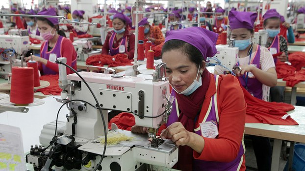 Garment workers sew clothes in a factory outside of Phnom Penh, Aug. 30, 2017.