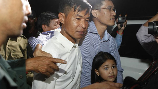 Former RFA reporters Uon Chhin and Yeang Sothearin are shown outside Cambodia's Prey Sar Prison, Aug. 21, 2018.