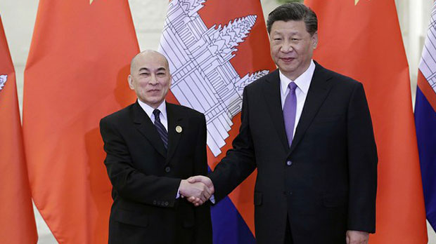 Chinese President Xi Jinping (R) shakes hands with Cambodian King Norodom Sihamoni (L) at the Great Hall of the People in Beijing, May 14, 2019.