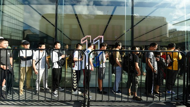 Customers queue outside an Apple store to buy the latest iPhone models in Hangzhou in China's eastern Zhejiang province on Sept. 20, 2019.