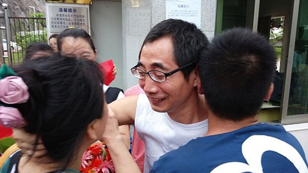 Shenzhen labor activist Wu Guijun is greeted by family and friends in an undated photo.