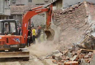 "Authorities demolishing ""illegal"" houses in Wuhan in central China's Hubei province, May 7, 2010."