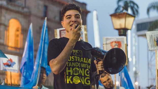 Australian student activist Drew Pavlou, who has repeatedly criticized Queensland University's close ties with the Chinese Communist Party and faces expulsion, in an undated photo at a protest in support of Hong Kong and Uyghur causes.