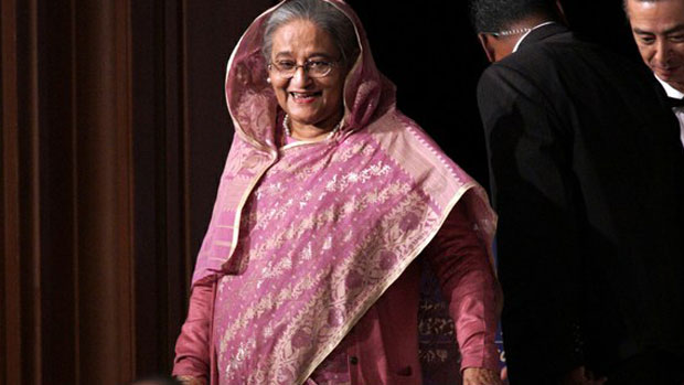 "Bangladesh Prime Minister Sheikh Hasina leaves the stage in Tokyo after delivering a speech at a session of the International Conference on ""The Future of Asia,"" May 30, 2019."