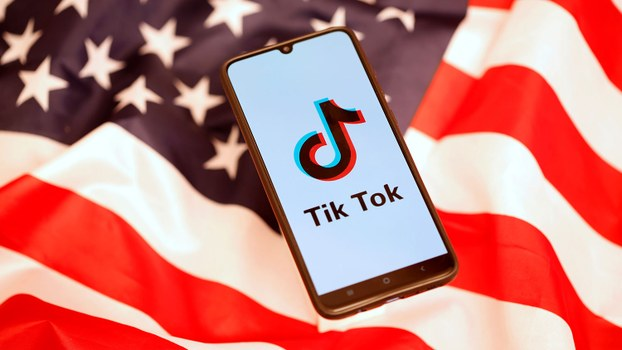 The TikTok logo is shown against an American flag in a file photo.