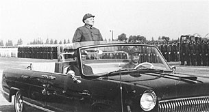 Deng Xiaoping, Chairman of the Central Military Commission, reviews Chinese troops during a military parade in Beijing, Oct. 7, 1981.