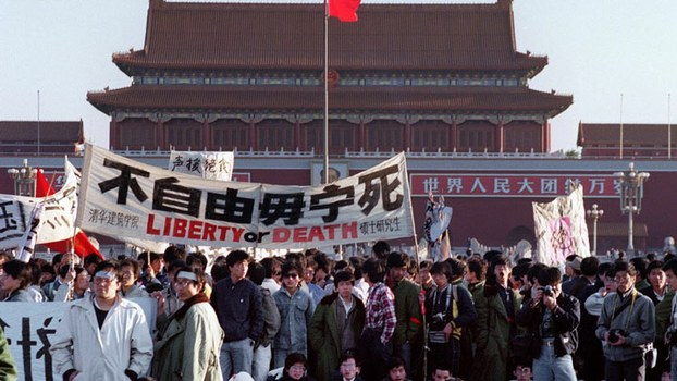 Students and local people gathered at Tiananmen Square in Beijing after an over-night hunger strike as part of the mass pro-democracy protest against the Chinese government, May 14, 1989.