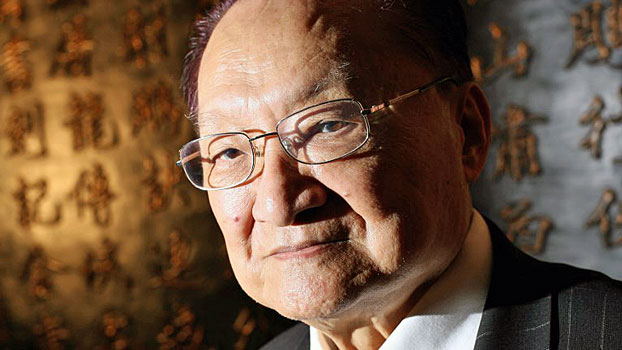 Renowned novelist Louis Cha, whose epic martial arts thrillers inspired numerous films and sold some 300 million copies worldwide, poses in his office in North Point on Hong Kong Island in a file photo.