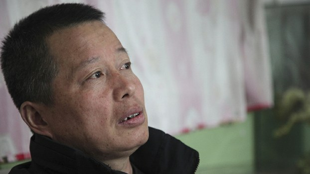 Gao Zhisheng talks to journalists in his cave home in Shaanxi province, in a file photo.