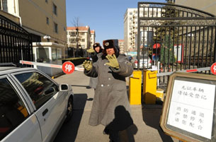 A security guard tries to stop photos being taken outside Liu Xiaobo's home in Beijing, Dec. 28, 2010.