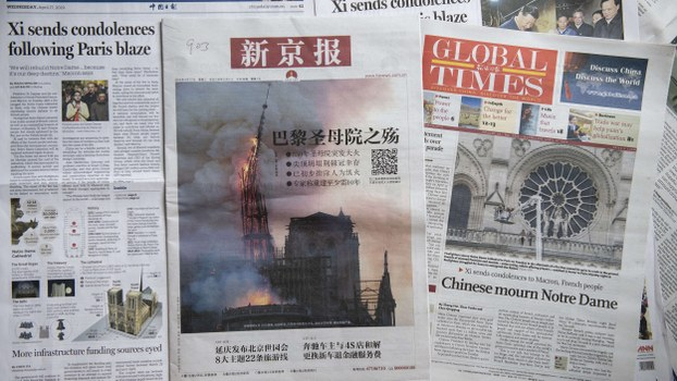 Front pages of the China Daily (L), the Beijing News (C), and the Global Times (R) featuring the Notre-Dame Cathedral disaster, are shown in Beijing, April 17, 2019.
