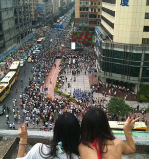 """A photo submitted by a netizen shows two women looking down on a rally held by the """"Support Cantonese"""" movement in Guangzhou."""