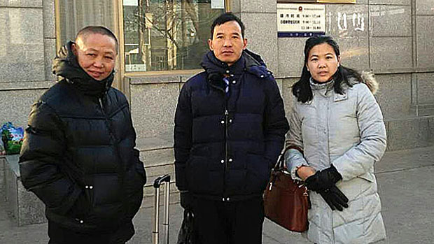 Yu Wensheng's wife Xu Yan (R) and lawyers are shown after visiting Yu in detention in Beijing, Jan. 24, 2018.