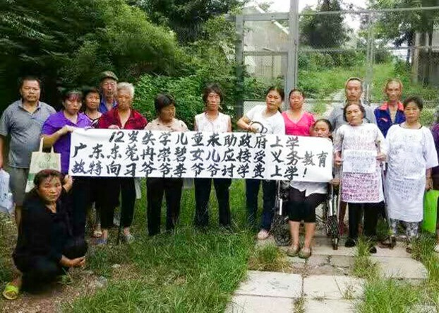 Petitioners whose children have been been denied access to school protest in Beijing's Fengtai District, Aug. 20, 2016.